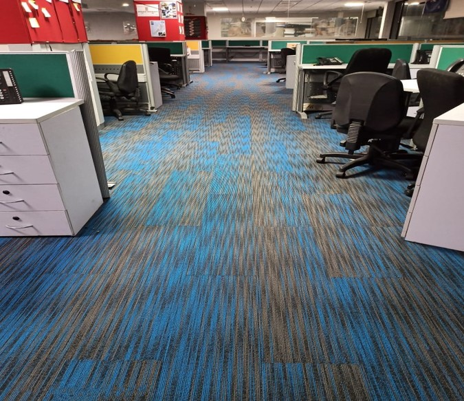 Vibrant tiles at WNS, Pune by Welspun Flooring